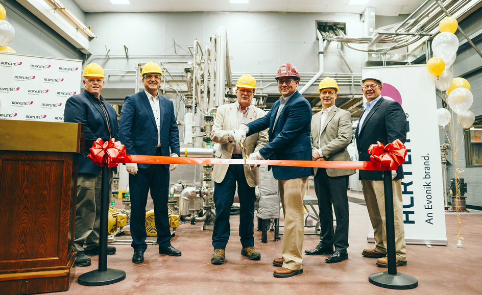 Ribbon is cut at Evonik's Osceola, Ark., site to announce the opening of its new compounding line. From left: Terry Gibbs, Siamak Djafarian, Scott Hopkins, Derek Beyer, Drew Scott, Jim Bunn.